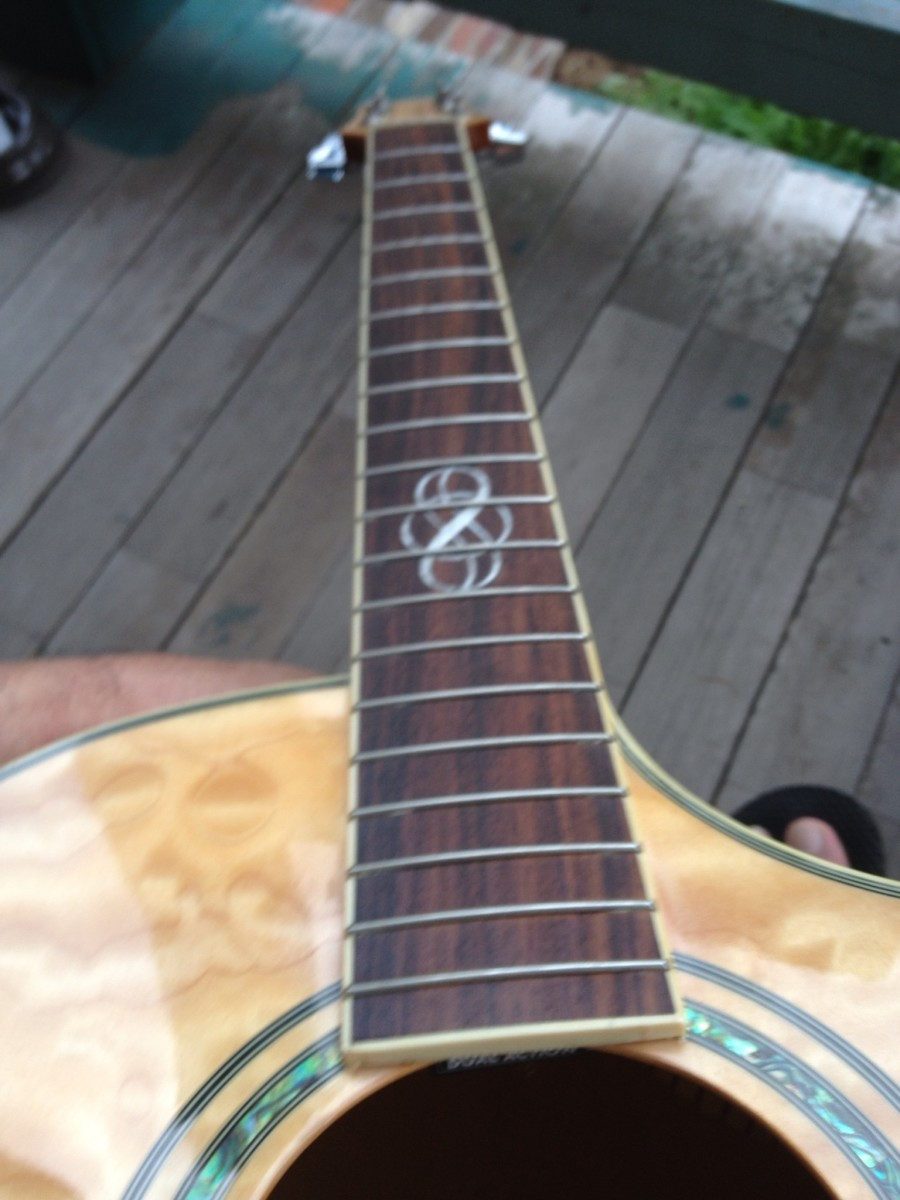 Always inspect the neck while going over your guitar.  As you can see, the frets are now fresh and alive with rich color.