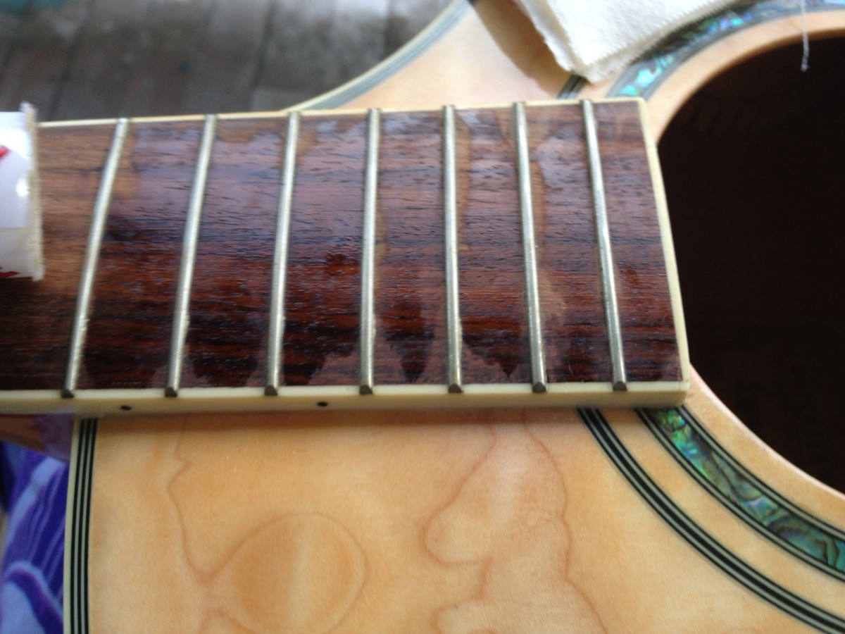 Working the polish into the fret board