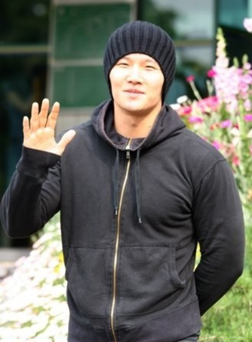 "Kim Jong Kook, seen here on the day he was discharged, opted to go for the ""public"" division and not the more physically demanding ""active"" division despite being known for being strong and healthy."