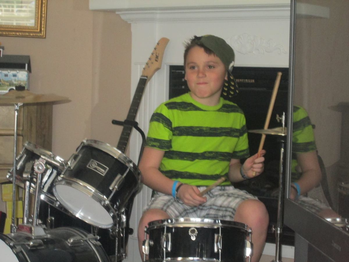 Douglas is still playing these drums at 10 years old.