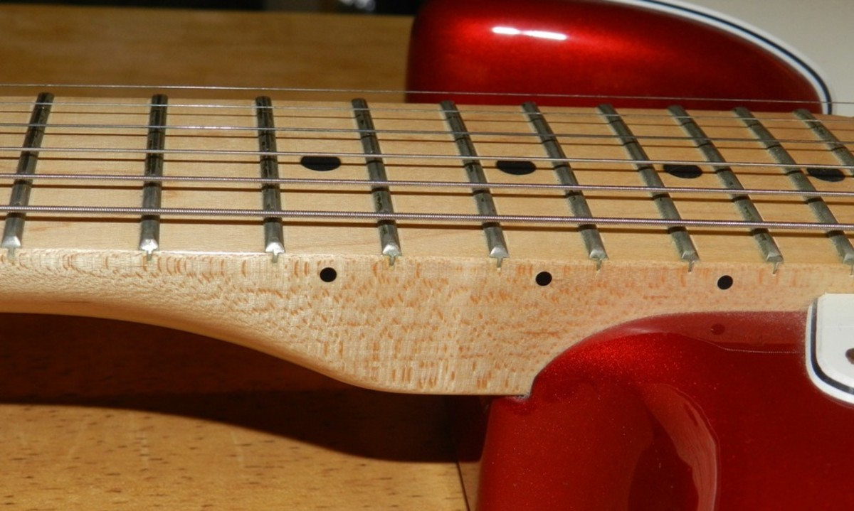 For hard rock and shred I prefer a one-piece maple neck and fingerboard.