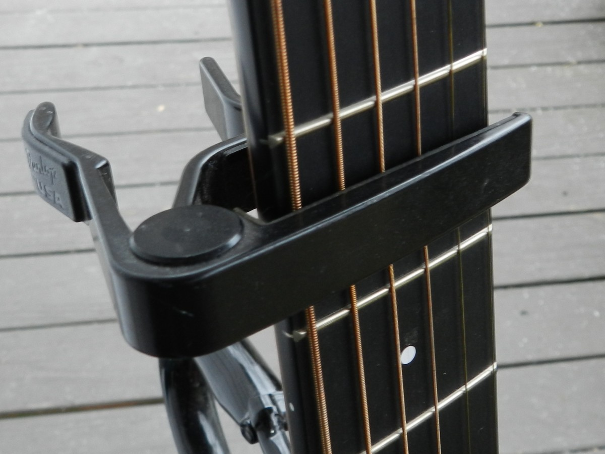 A capo helps you fret difficult chords higher up on the neck.