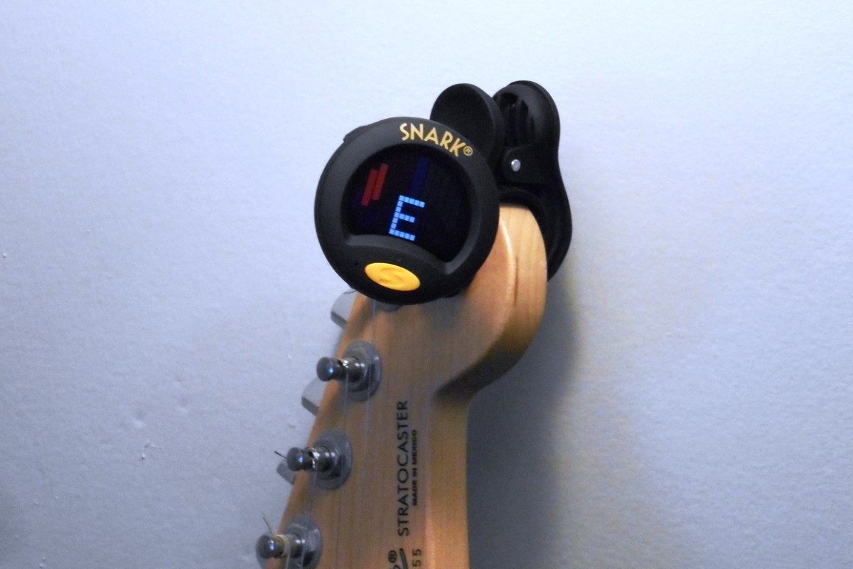Snark Tuners clip right onto the guitar headstock.