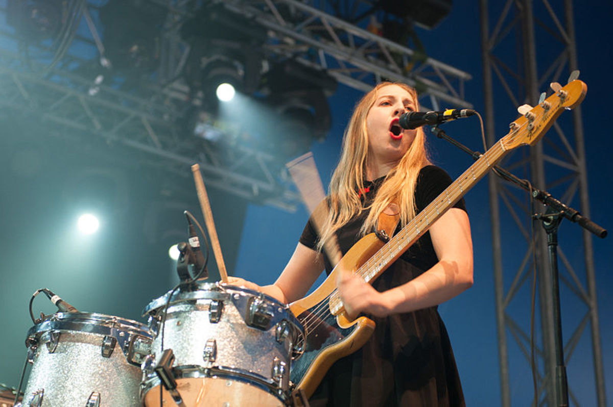 Este Haim of Haim playing bass and drums.