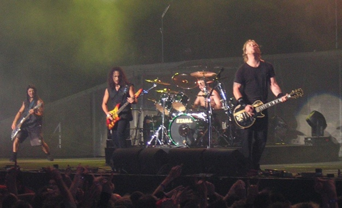 Metallica's guitarists Kirk Hammett and James Hetfield and bassist Robert Trujillo.