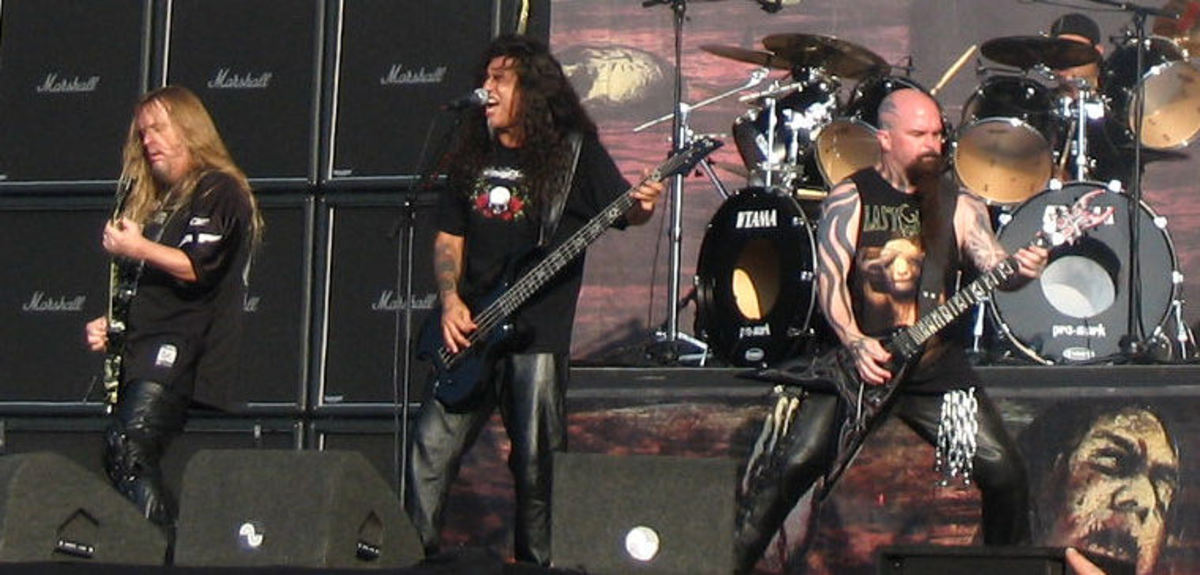 Slayer guitarists Jeff Hanneman (left) and Kerry King (right), and bassist Tom Araya (center).