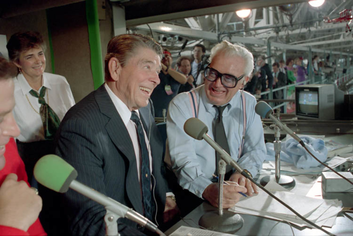 "Harry Caray with then US President Ronald Reagan during a September 30th, 1988 broadcast at Wrigley Field. Caray was renowned for leading Cubs fans in a sing along to ""Take Me Out to the Ball Game"" during the 7th inning stretch."