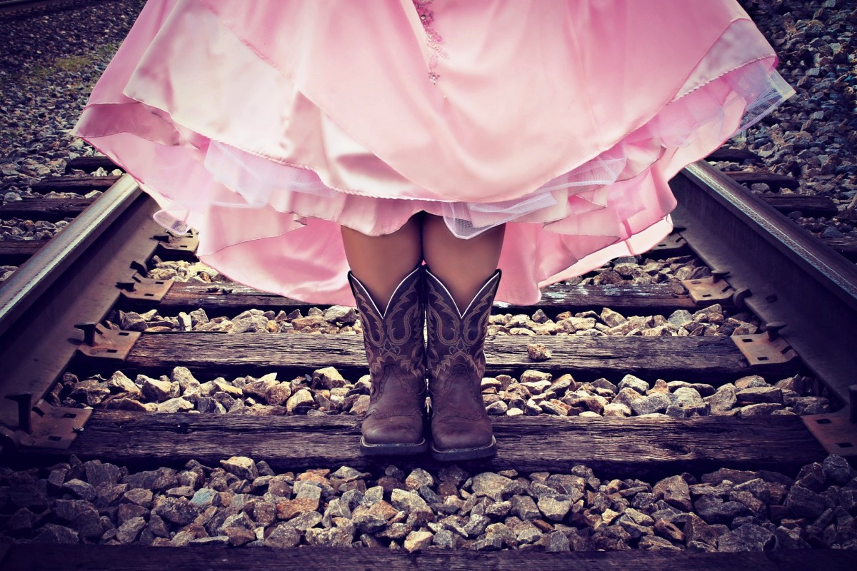 She's a cowboy's princess:  Boots, buckles, baubles and bling.