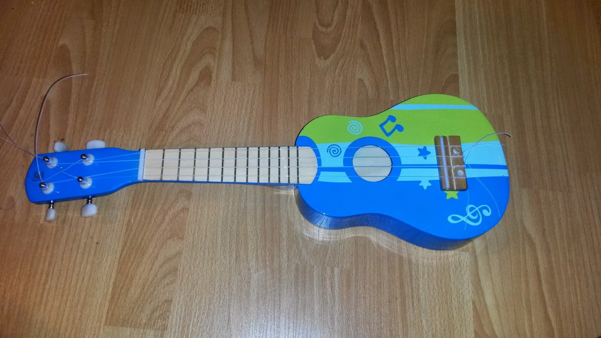 My newly strung ukulele. I'll cut the extra bits off soon.