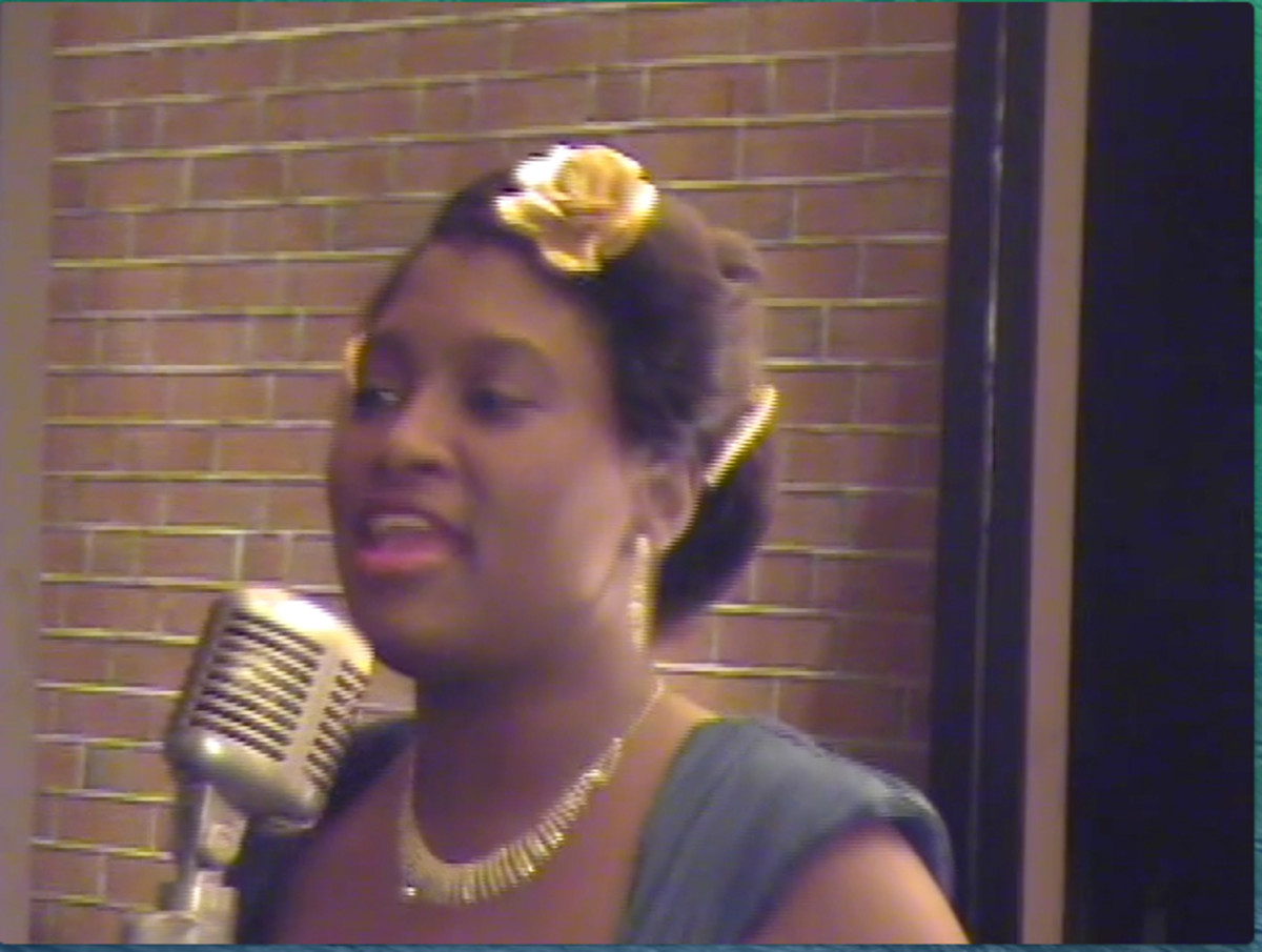 "This talented actress; singing Duke Ellington's great work called ""Satin Doll"", is portrayed as a vocalist in Duke Ellington's orchestra as they performed on Beale Street in the 1940's."