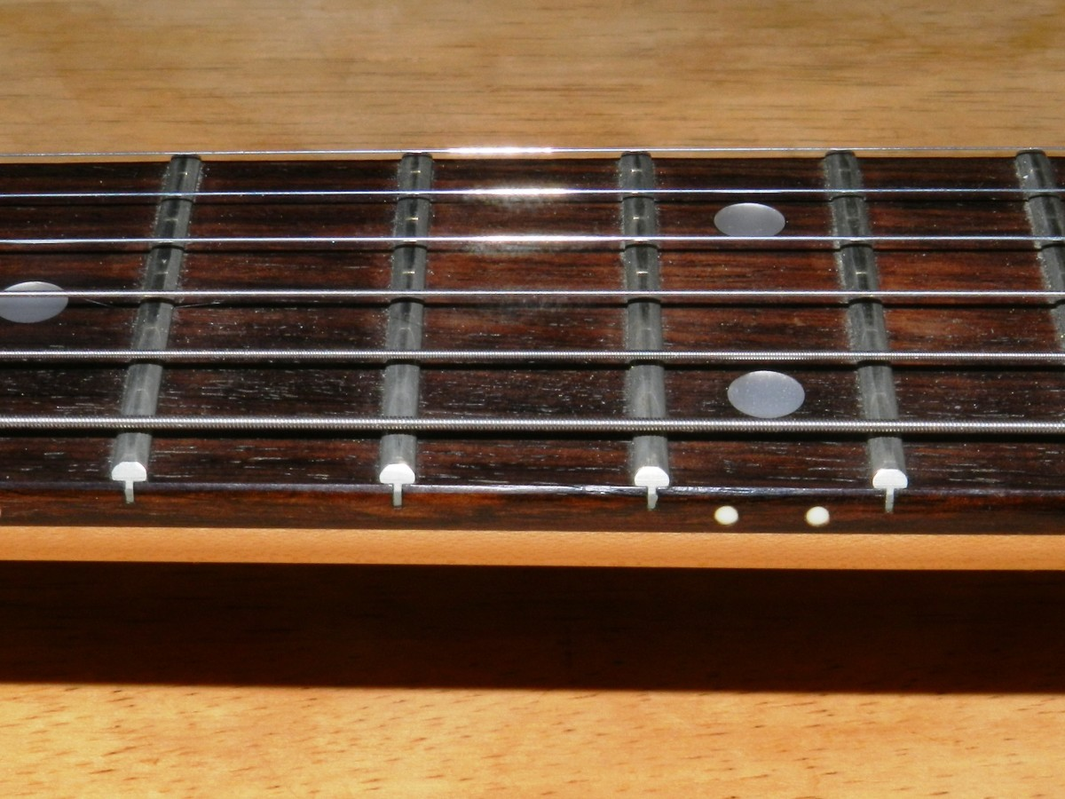 A rosewood fretboard requires occasional conditioning to keep it in good shape. This fretboard needs a little TLC.