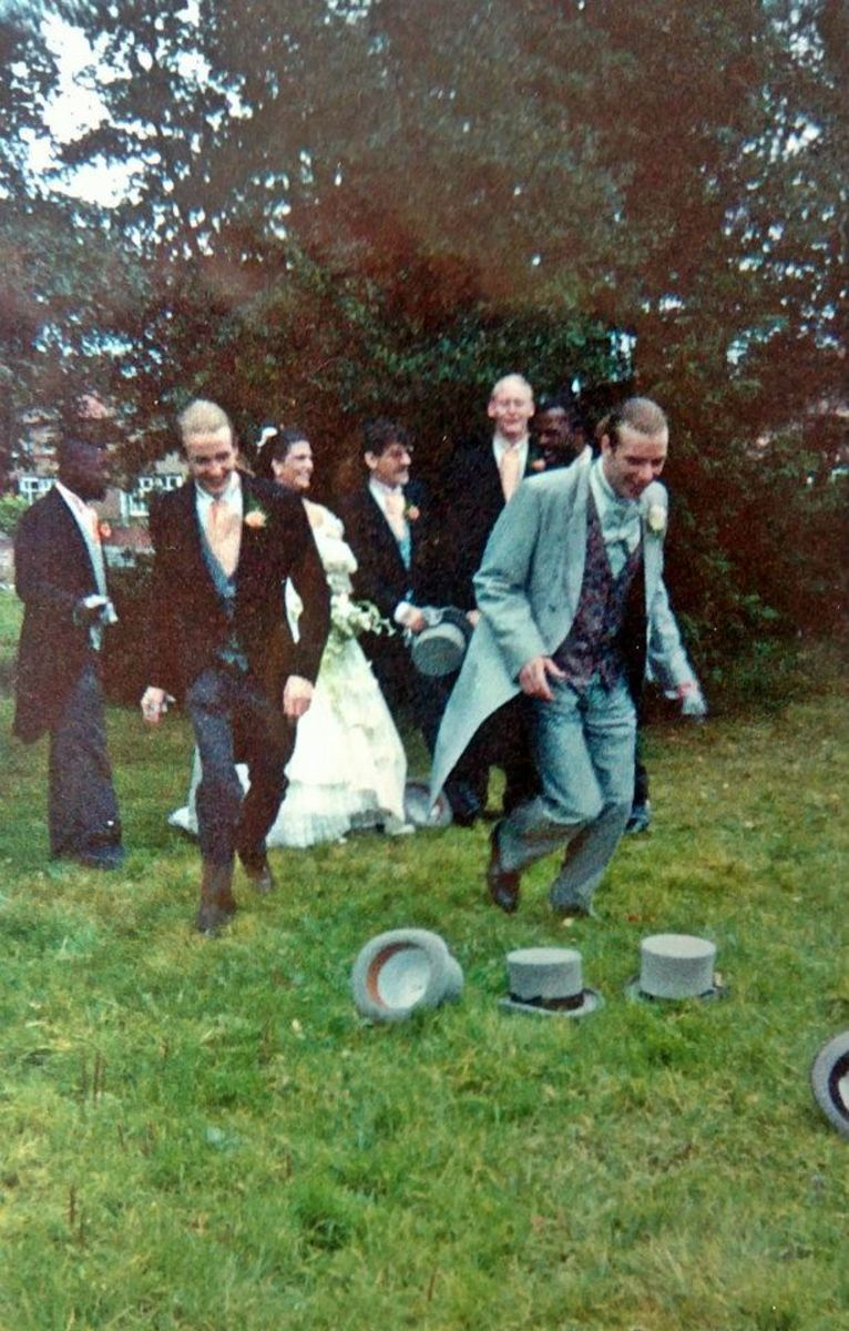 Andy and Jackie's wedding in 1991 - the guys had thrown their top hats in the air for a photo. My friend Pete is on the left, running to retrieve his hat with the groom. My friend James is at the back on the right.