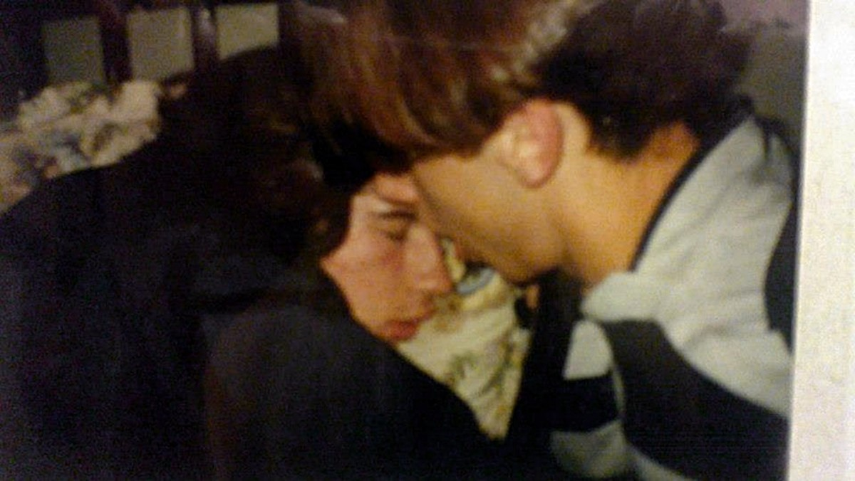 Paul from Carlisle asleep in a chair at a party, with Chris trying to wake him up (June 1991).