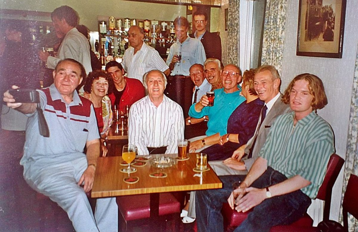 My cousin Jon (right) at my dad's birthday party. Dad is in the turquoise shirt sitting on the right, next to mum. Dad's twin brother, Leonard, is in the centre in the white shirt.