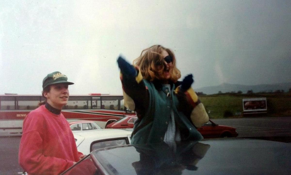 Mandie dancing through my car sunroof on the motorway services, watched by Franny (in the red jumper).