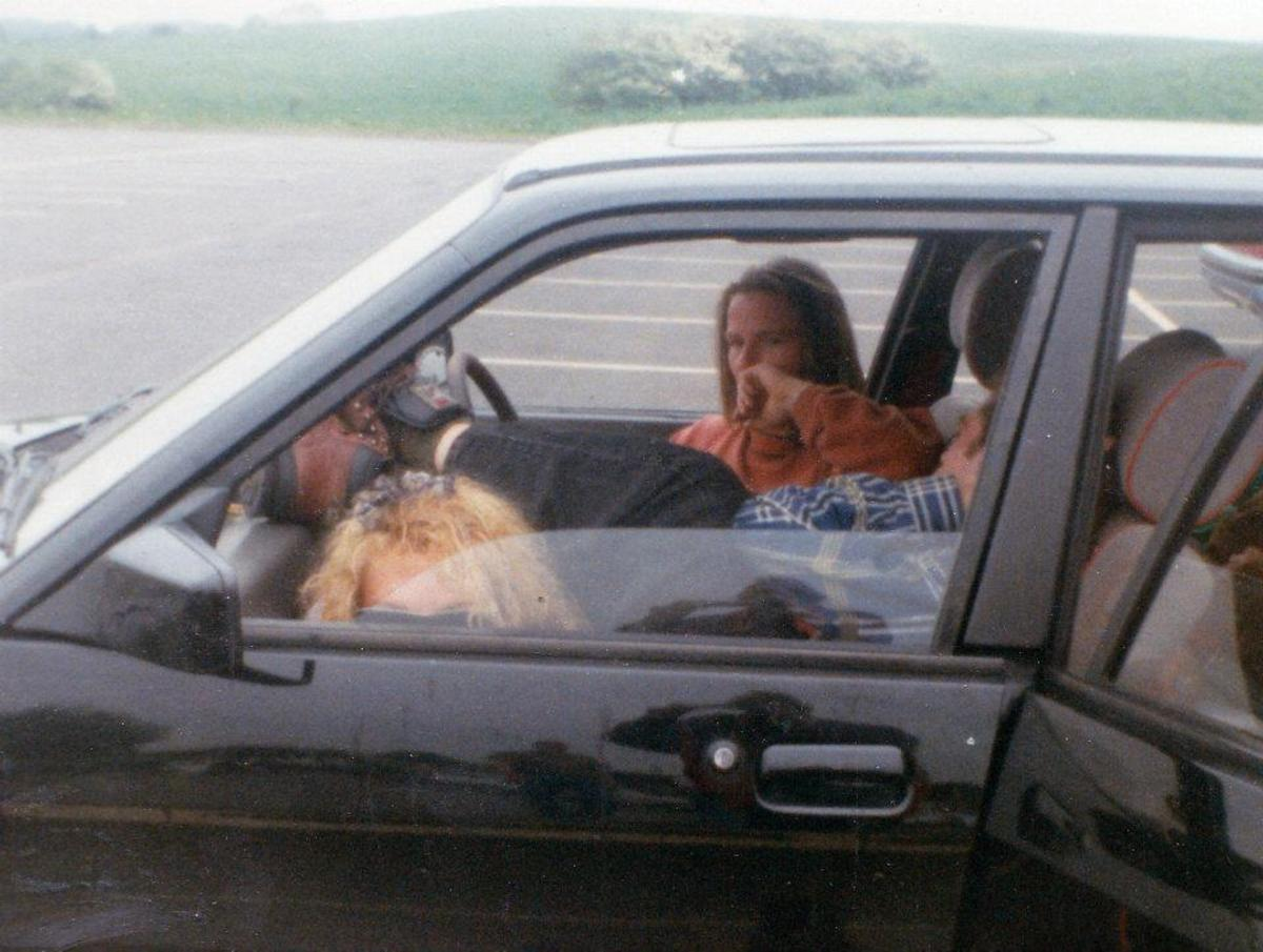 Sitting in my car on the services - Lou in the driving seat, my cousin Jon in the passenger seat and me on the floor.