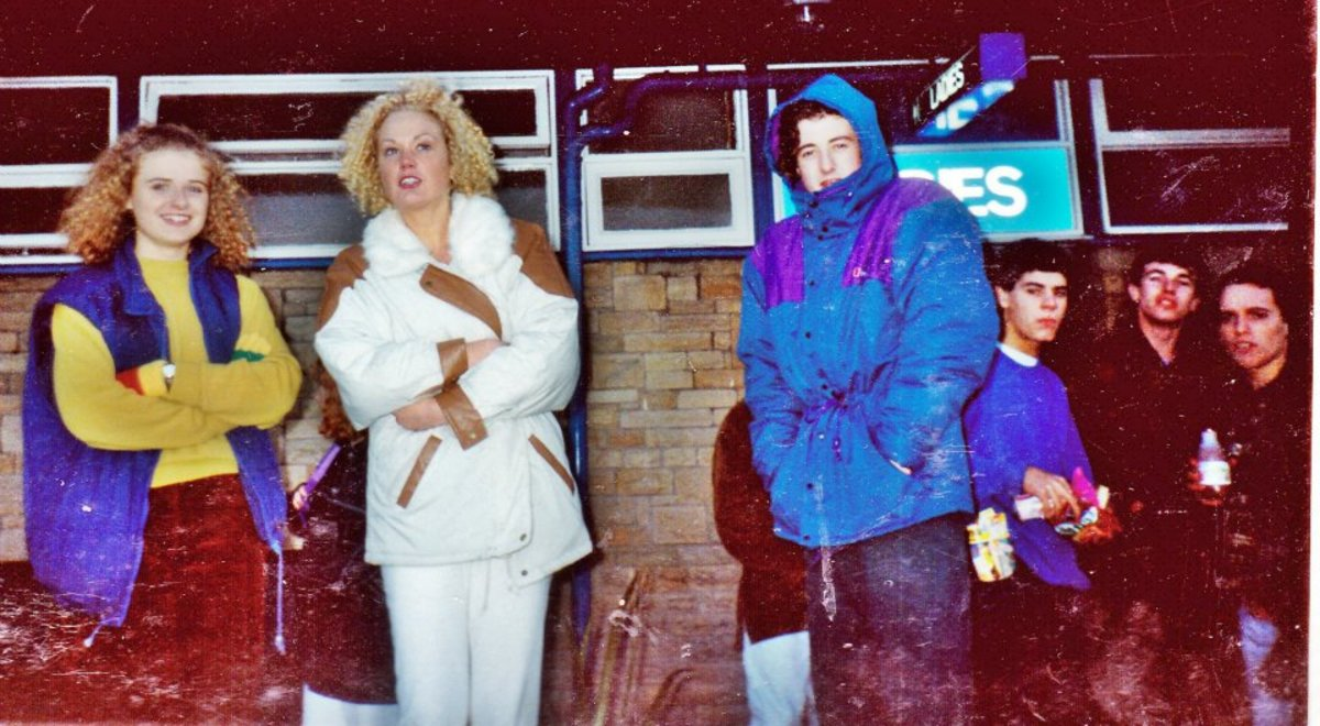 Jane (in white) with Phil in the hooded coat - at the services.