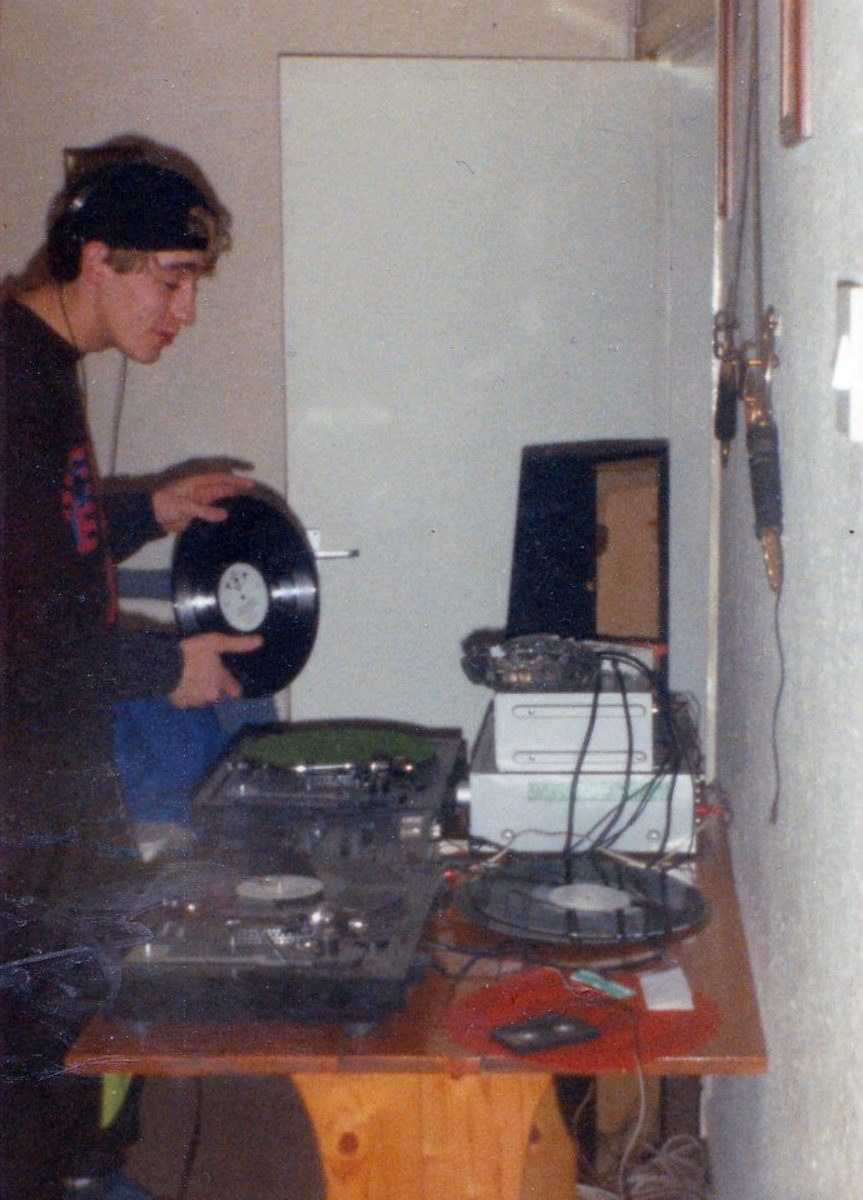 Dave Roberts on the decks at a house party (1991).