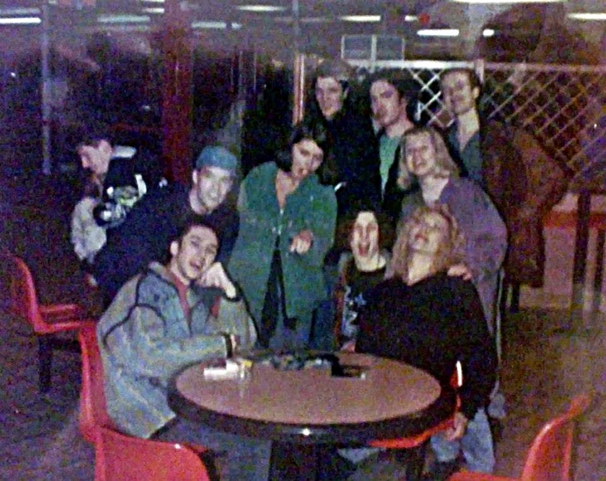 Hanging out at the motorway services - Carl (Bollie) seated on the left; Carol in green jacket (standing, centre); me seated on the right, next to Grayson, with Adele (purple jacket) standing behind me. Standing at the back (right) is Pete.