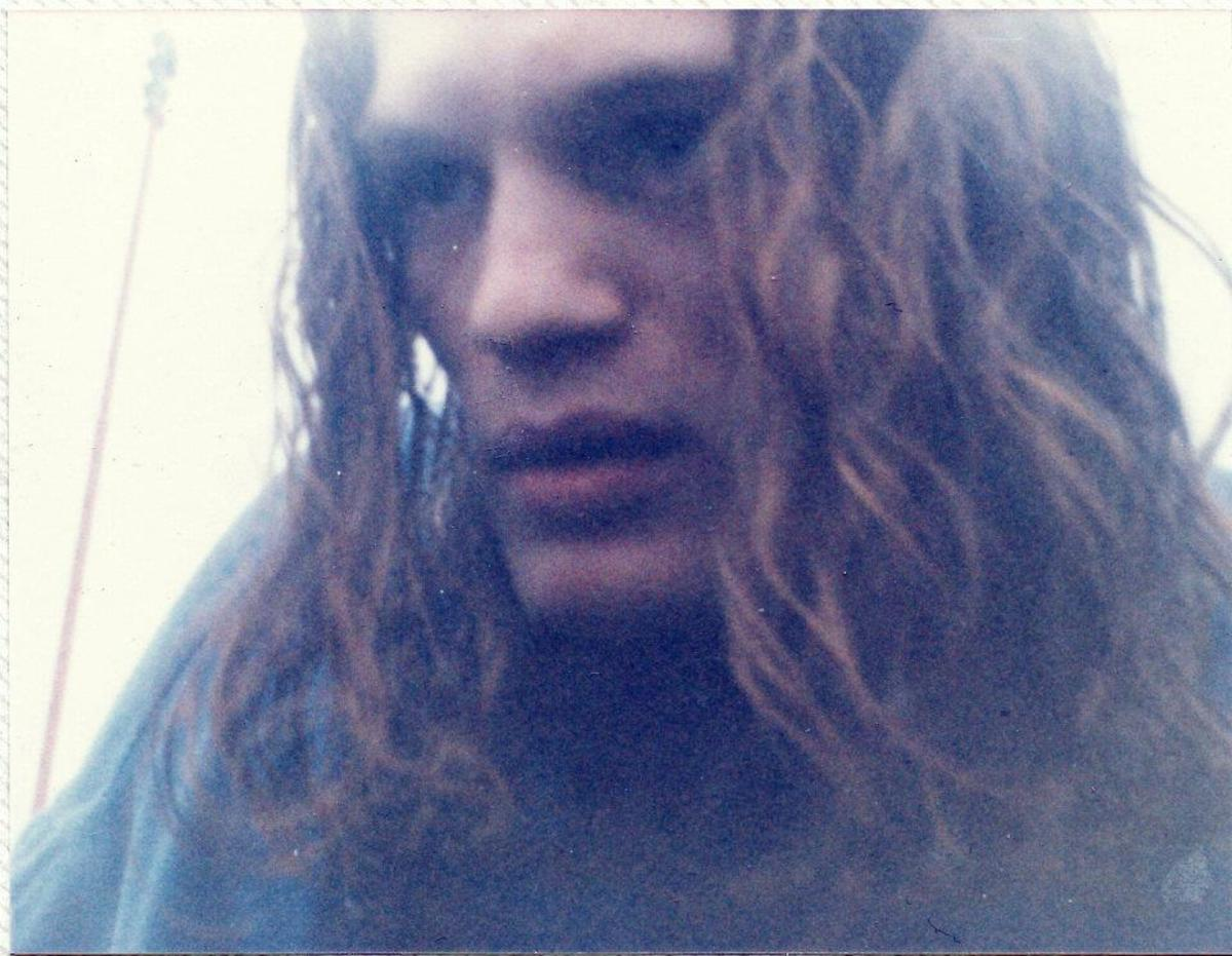 My cousin Jon getting into my car after a night's partying (1991).