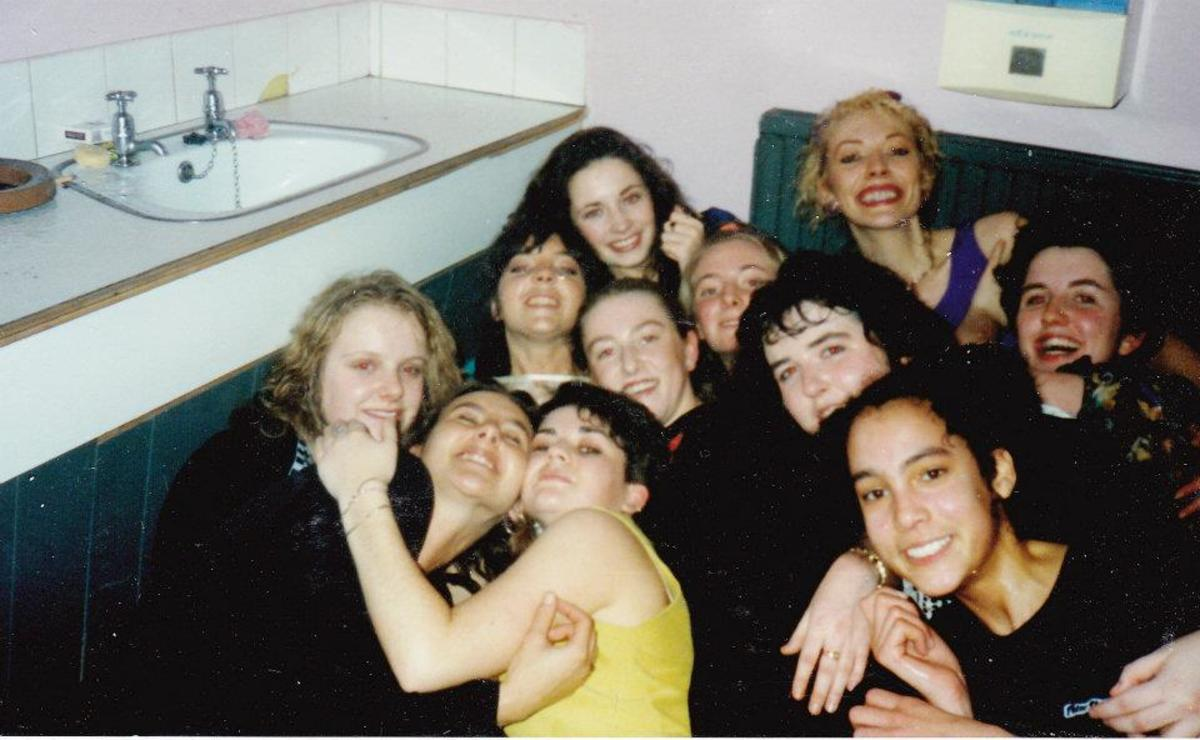 In the ladies' toilets in Monroes (1990). I am at the back in the purple top.