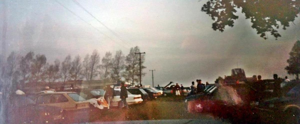 Party-goers around their cars after Eclipse (1991).