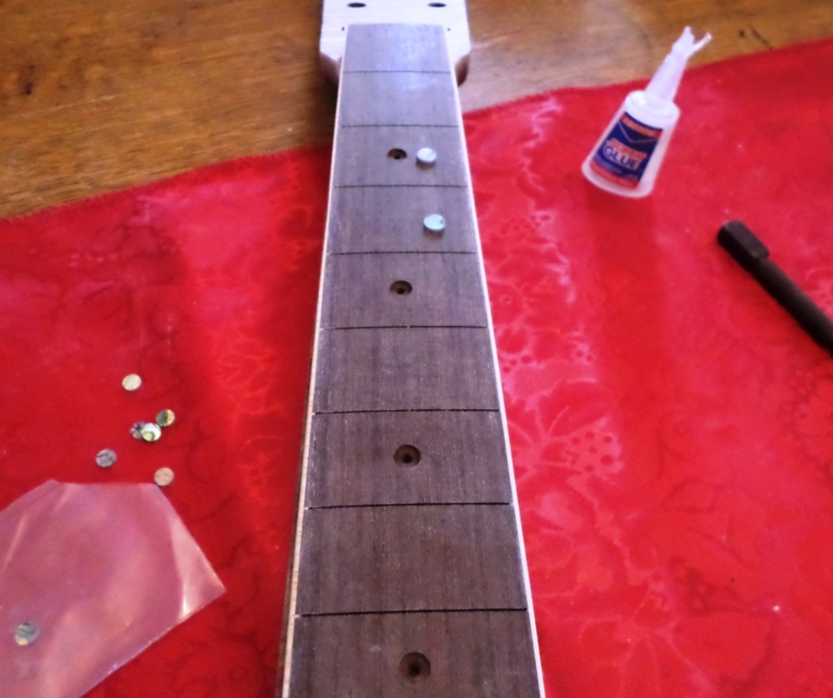 Inlaying the fret dots.
