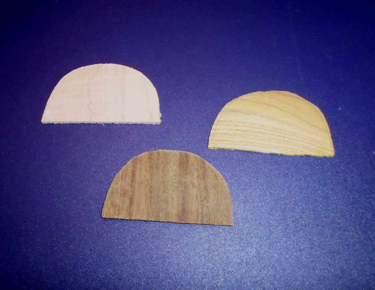 Pieces for a decorative neck butt cap.