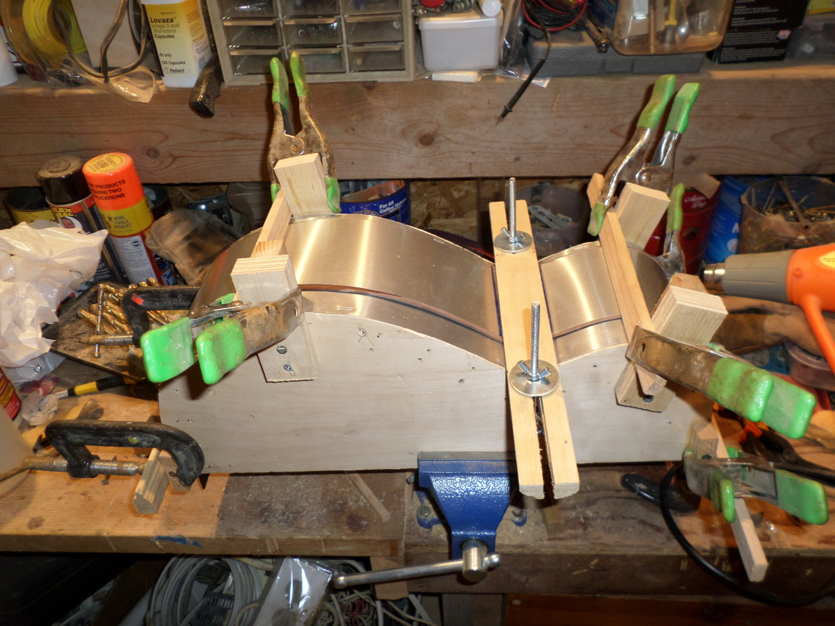 One side clamped to the bending form.