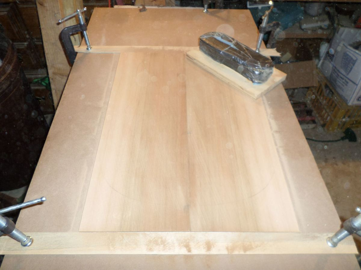 Hand sanding to achieve the proper thickness.