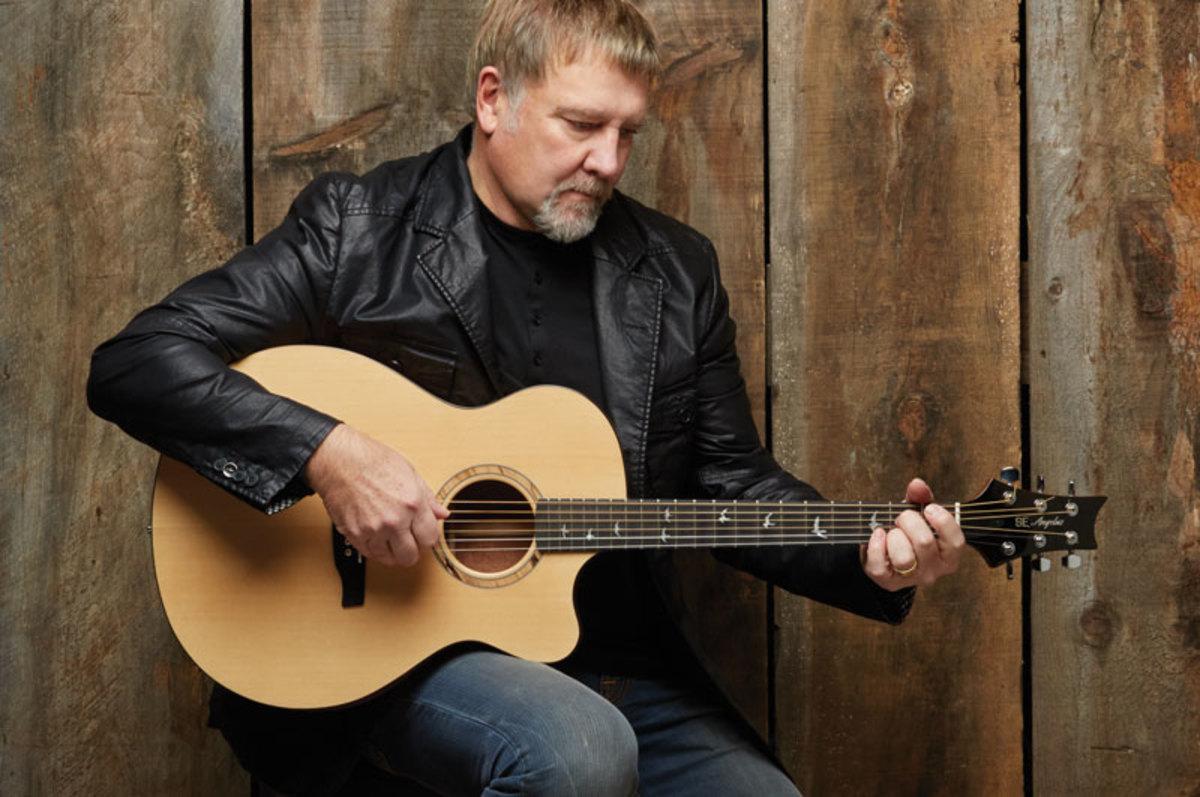 Alex Lifeson with his PRS SE Thinline guitar