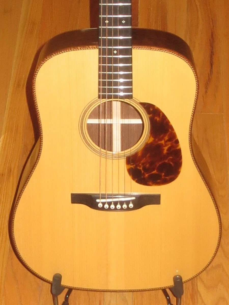 The binding on this beautiful guitar is of curly koa wood. What a stunner this thing is.