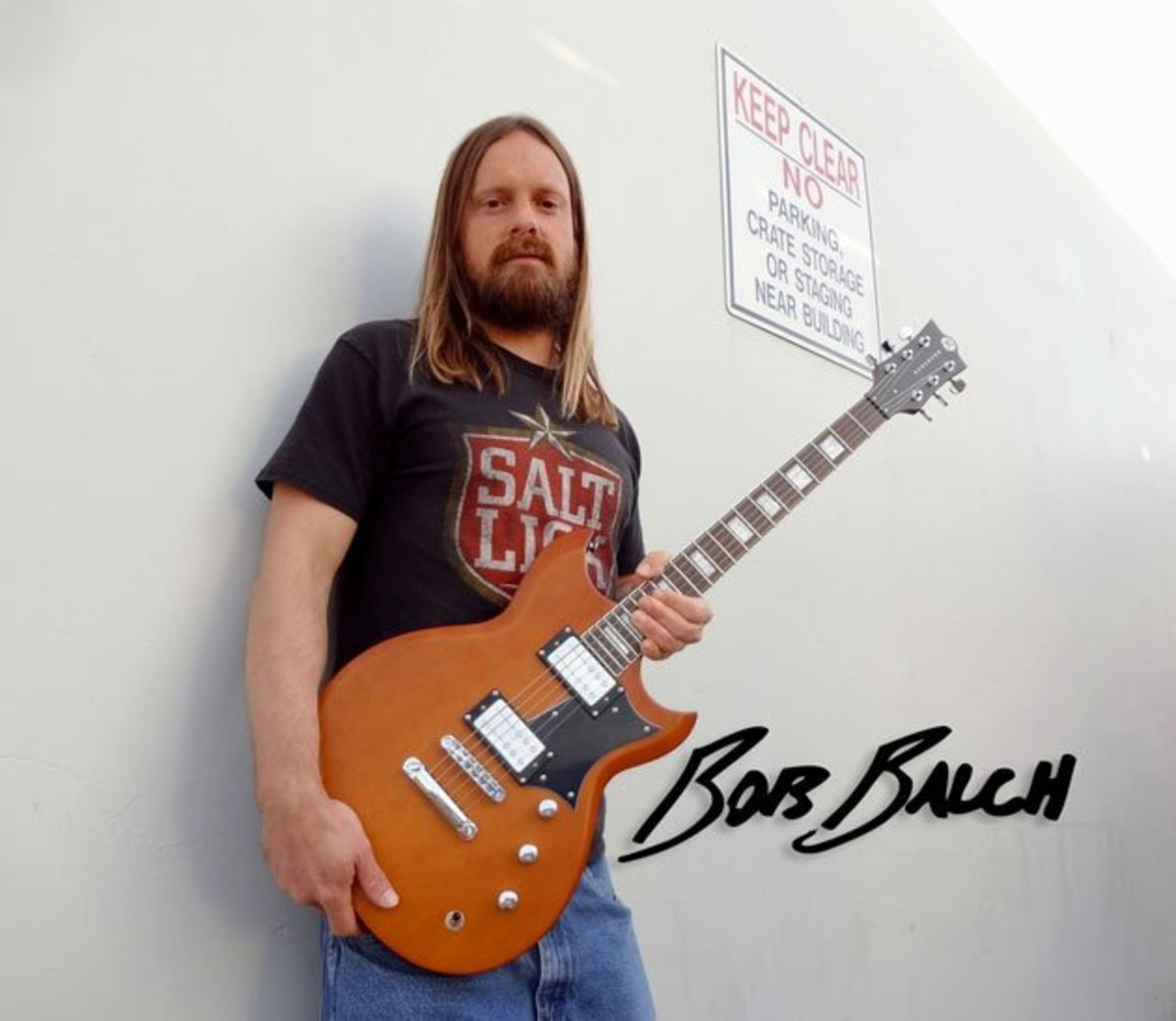Bob Balch of Fu Manchu holding his Reverend Signature guitar