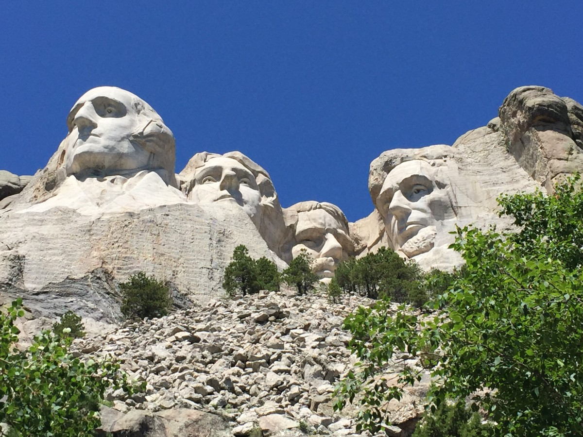 Mt. Rushmore is an American historic monument well worth seeing. It features the faces of George Washington, Thomas Jefferson, Theodore Roosevelt and Abraham Lincoln. The heads are nearly 60 feet high, carved into South Dakota's granite.