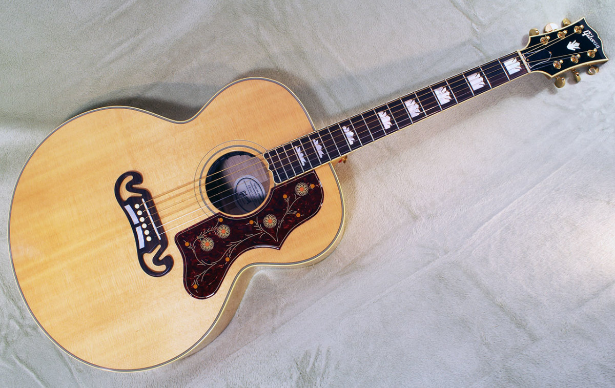 The Gibson J-200 with a fine natural finish.