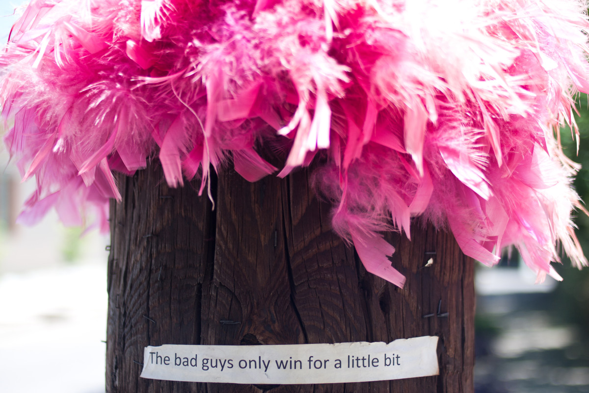 "Optimistic lamp post:  ""The bad guys only win for a little bit."""