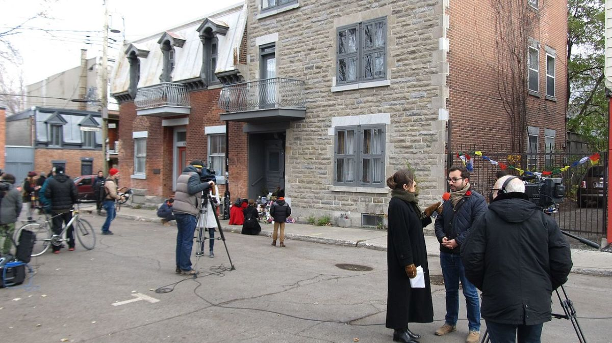 News crews gather in front of Leonard's Cohen's home in Montreal, following the announcement that the popular poet-singer had just passed away.