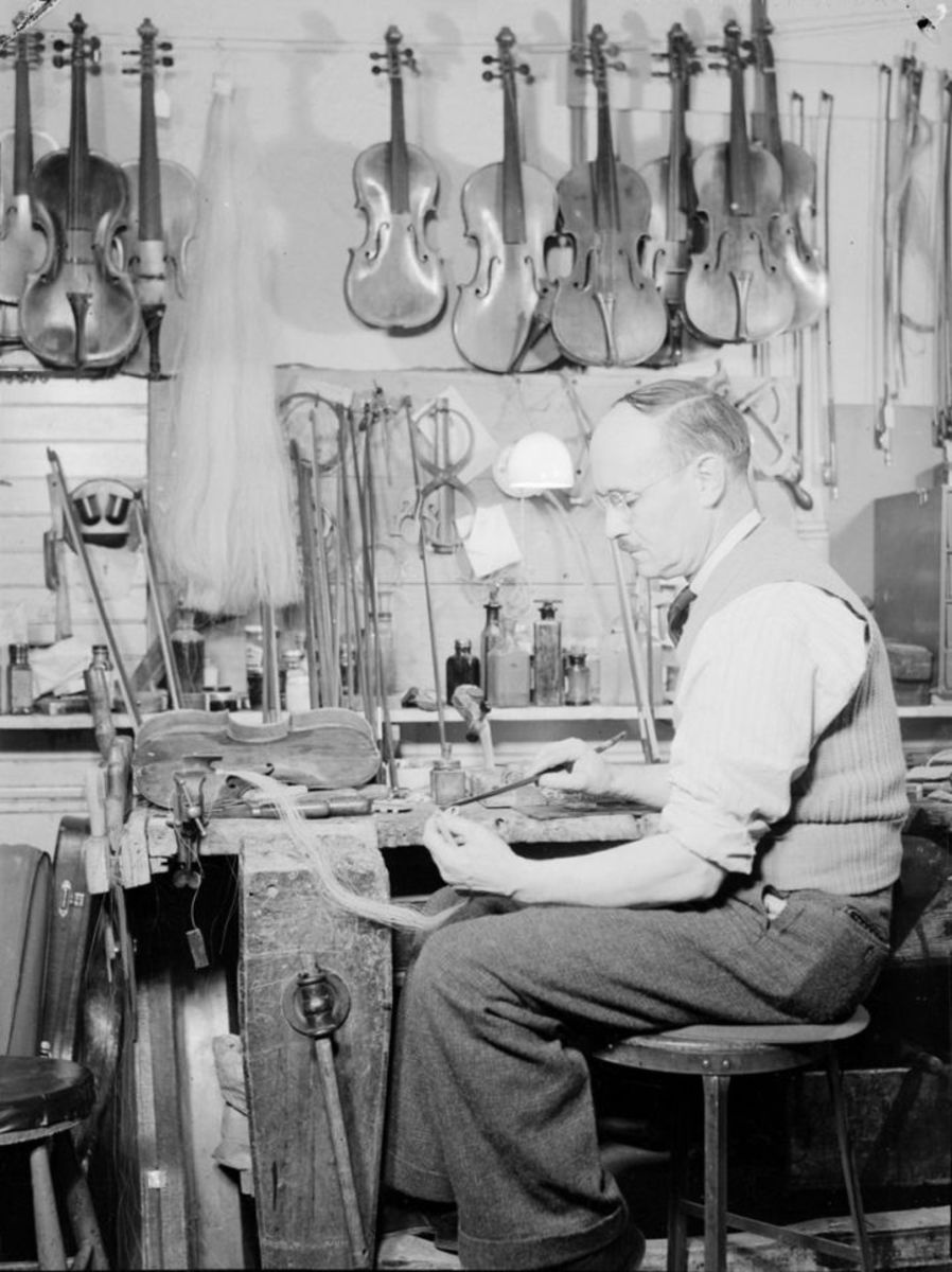 Mr Forget, luthier, sets a horsehair bow.We note violins, violas and various tools in the workshop of the craftsman of stringed instruments.