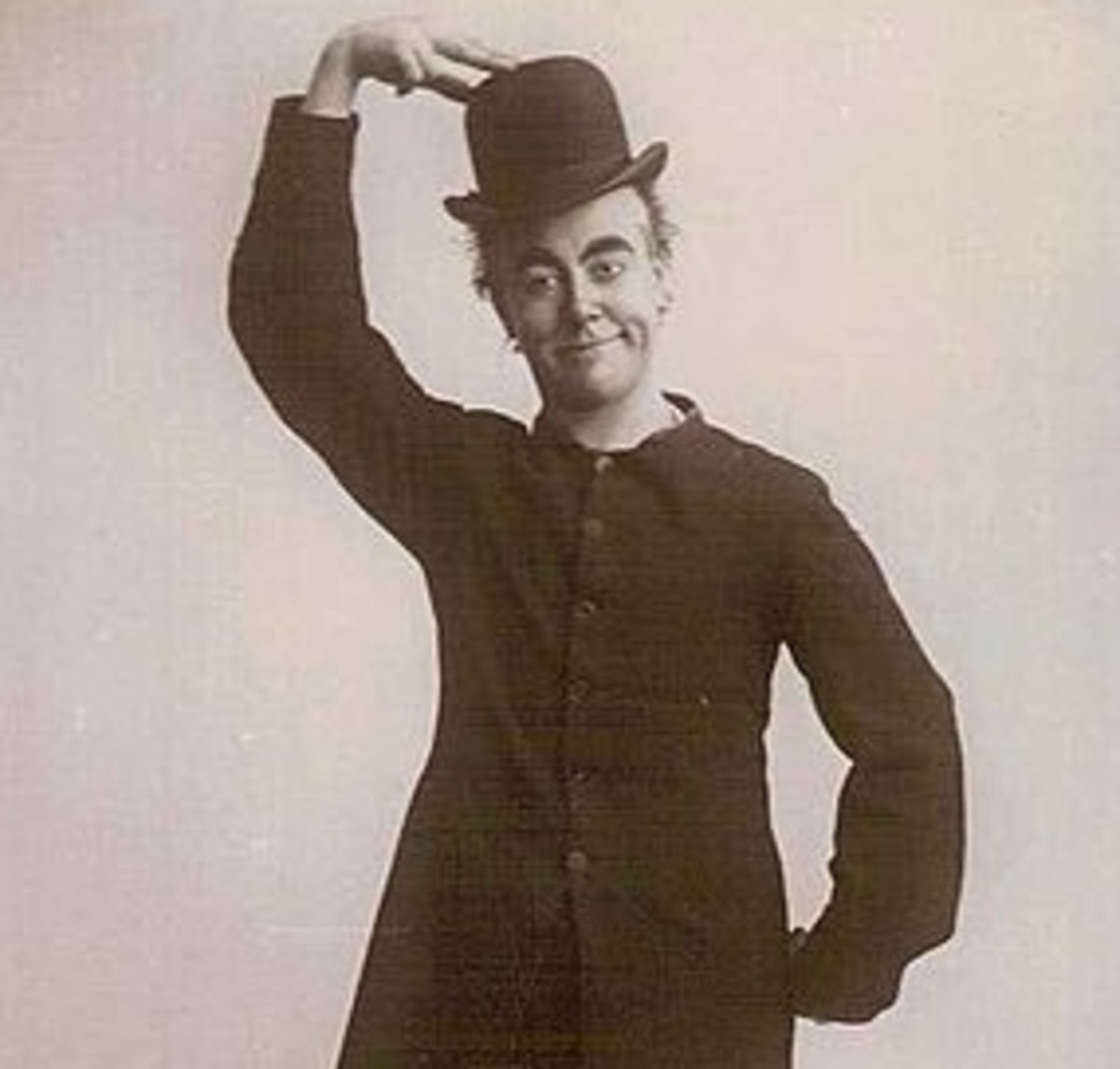 George Robey. Later, he squashed down the bowler for greater comic effect. He was knighted a few months before his death in 1954 at 85.