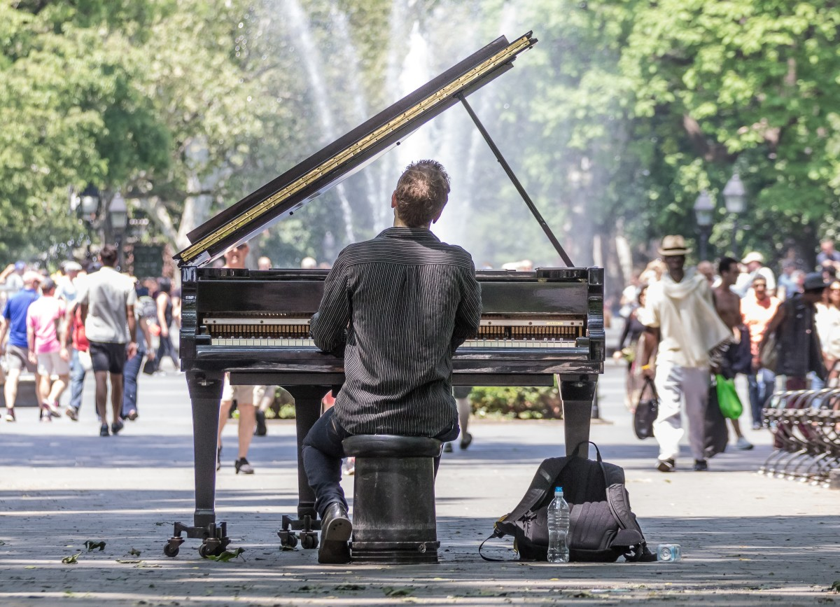 Street performer playing in Washington Square park.