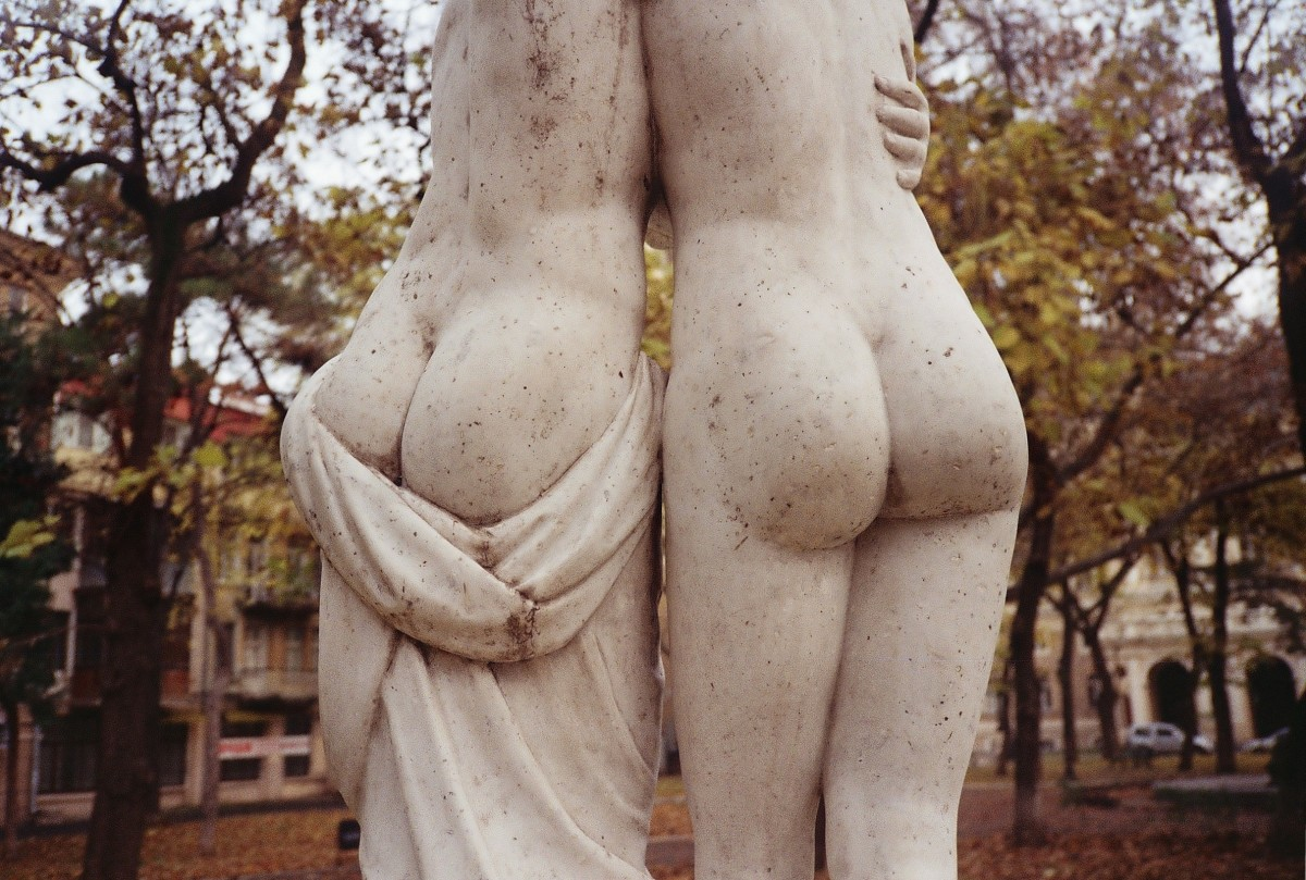 Why are statues always unclothed?  Give these gals a cover up.  They're obviously huddling from the cold.