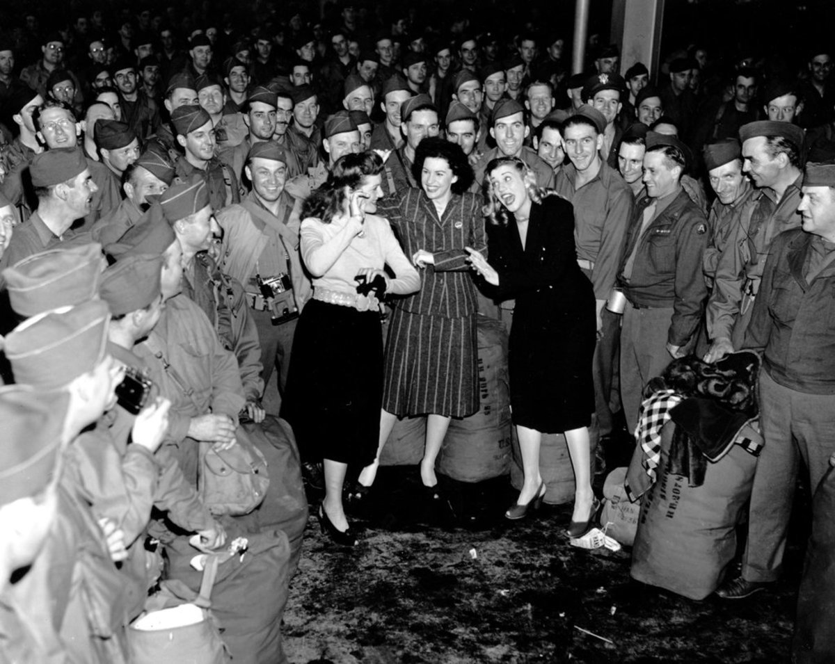 The Andrews Sisters performing for G.I.s during WWII