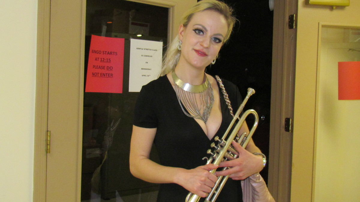 "M-Law, has been playing trumpet for 15 years. She attended school at VCU and has played with different groups. M-Law, has her own band called ""The Prophets of Jazz."""