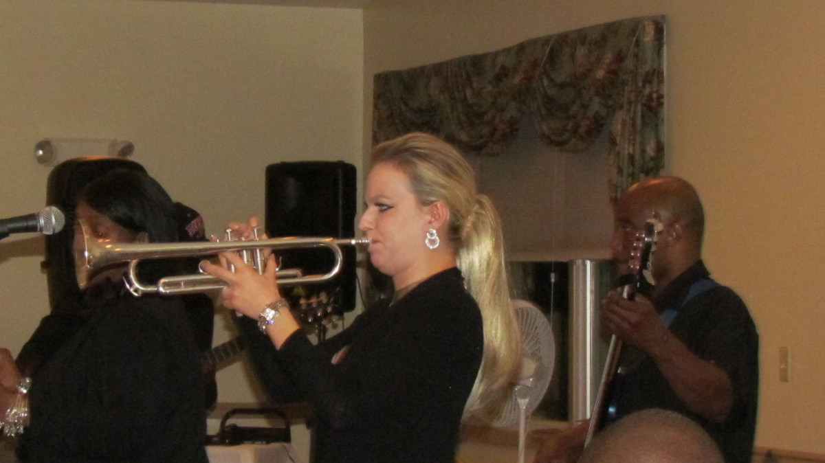 Diversified Group, performs with their powerful band as Mary-Law plays the trumpet.