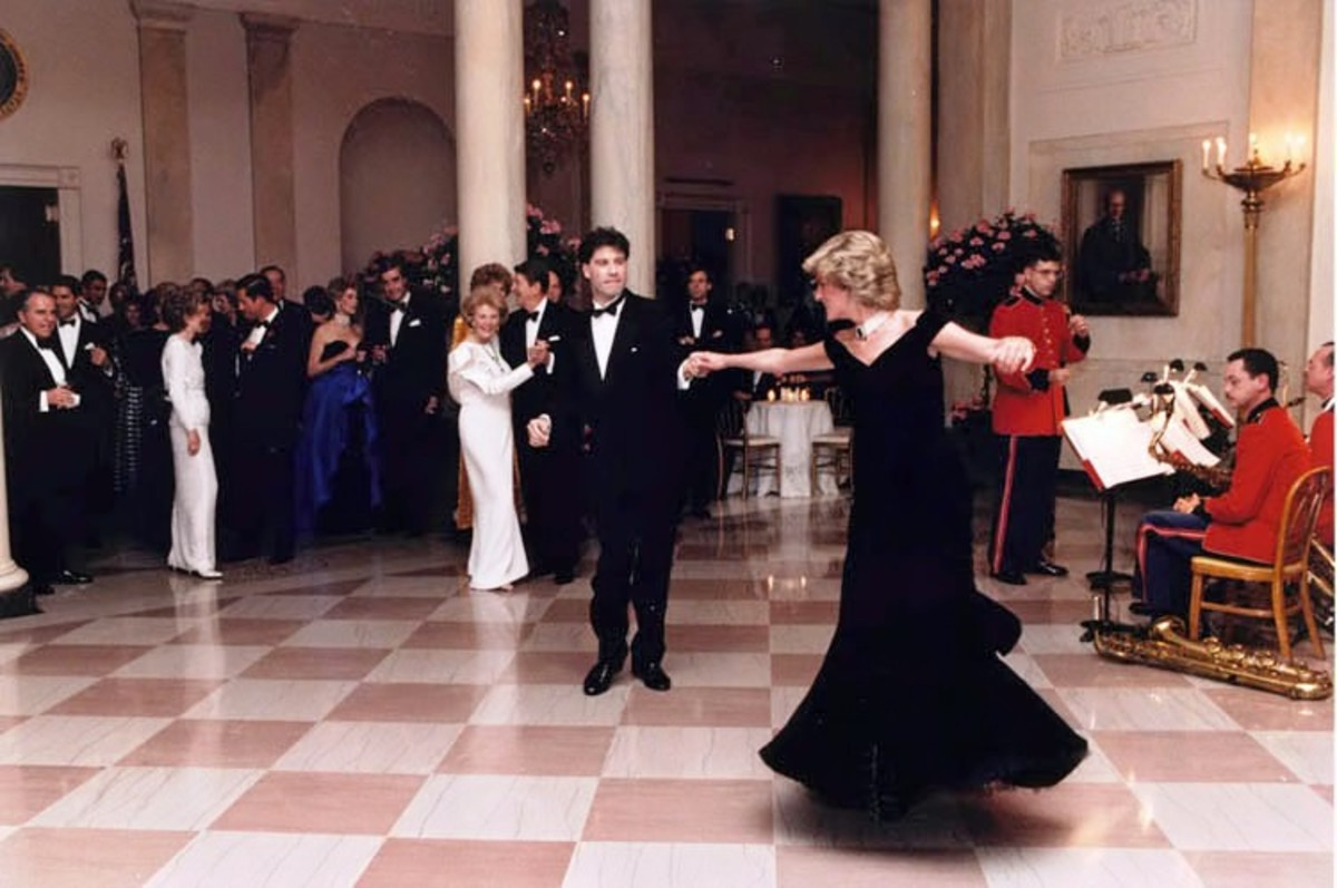 Princess Diana and John Travolta dance at a November 1985 White House dinner for the Prince and Princess of Wales.