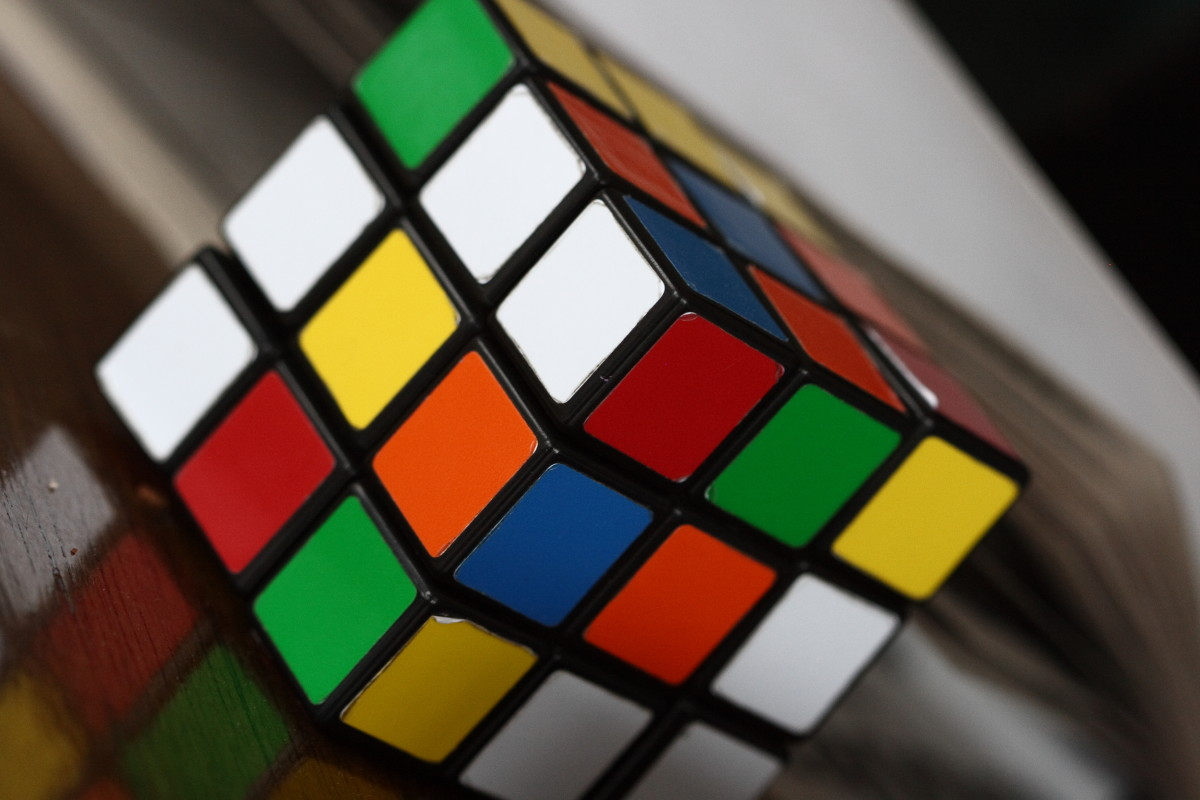 In the early 1980s, the Rubik's cube was a craze.  It's a 3x3x3 inch cube puzzle with six colors.  Top selling books were written about how to solve the puzzle. Speedcubing competitions also became popular.