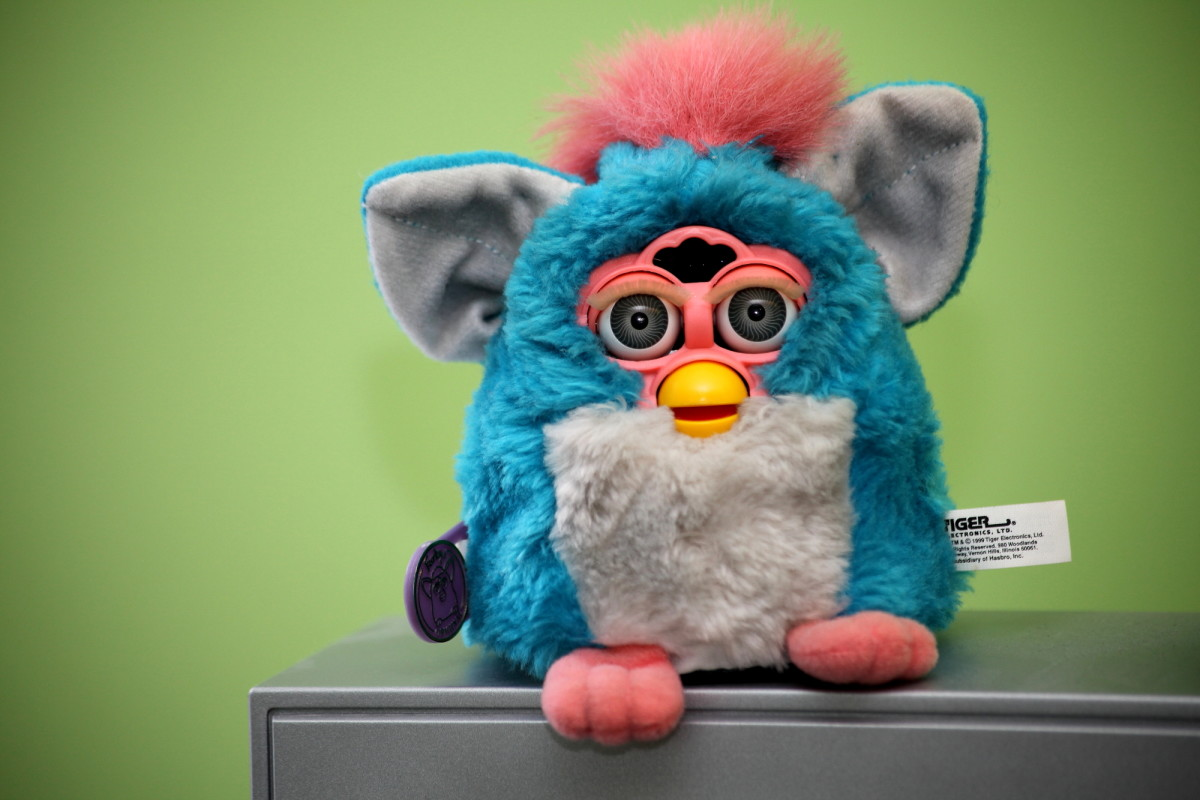 "Furbies were the ""it"" toy to have in 1998-2000.  The Furby looks like a hamster or owl and is a fuzzy robotic toy that speaks Furbish but gradually acquires English over time."