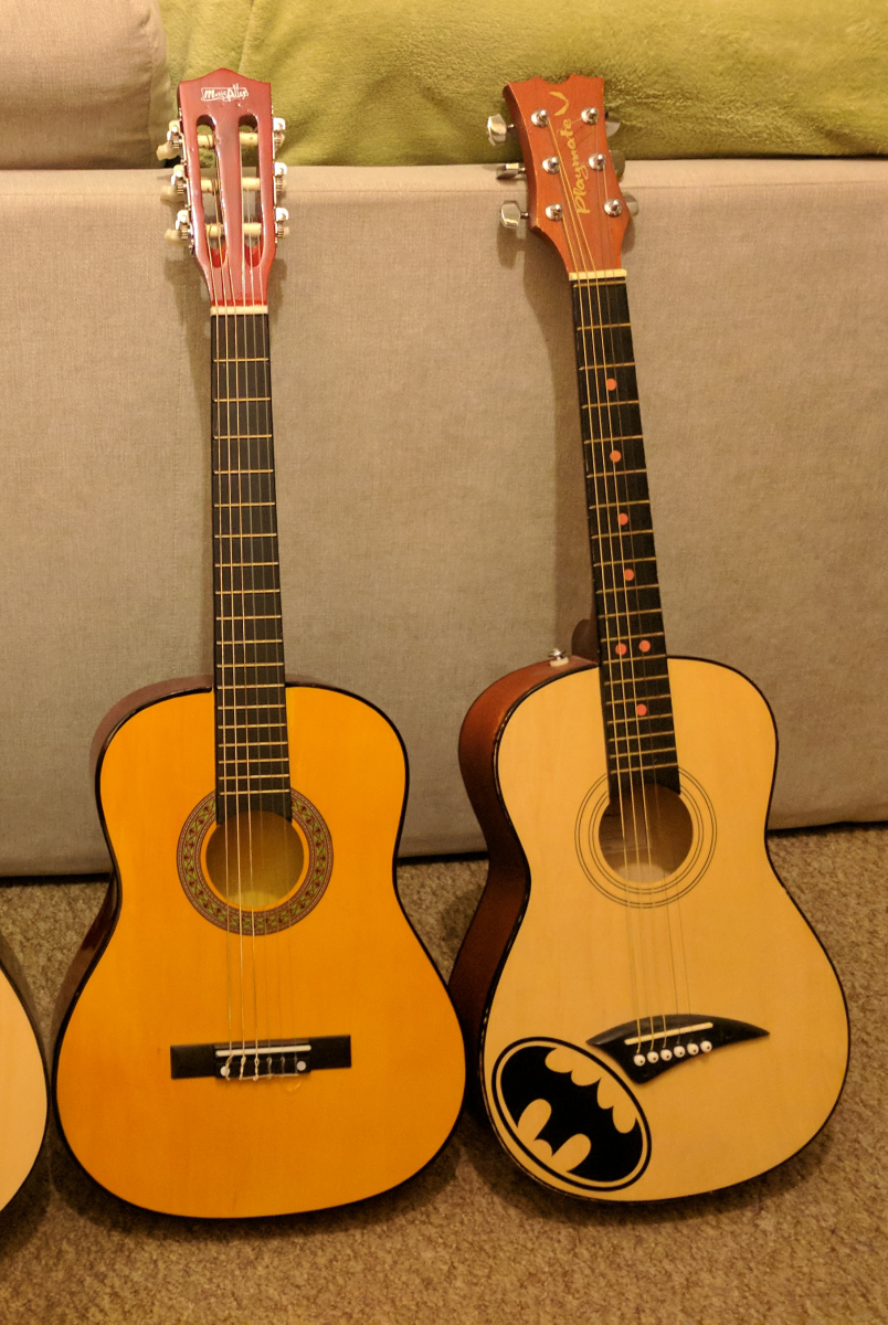 The size difference between classical and steel string guitars is most evident when comparing a half size steel string guitar (the one on the right) with a three quarter size classical guitar. They pretty much the same size.