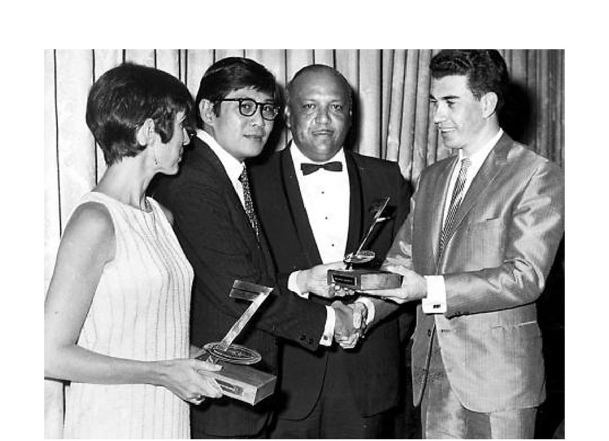 Hugh Gentles (right) presents a West India Records Limited (WIRL) Award for producer of best-selling 45 single to Leslie Kong (second left) in 1971