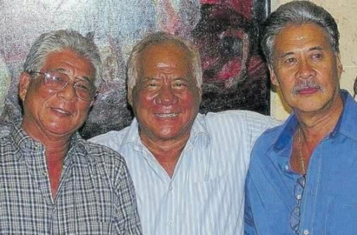 Byron Lee (left) with brothers Neville (middle) and Gene (right)